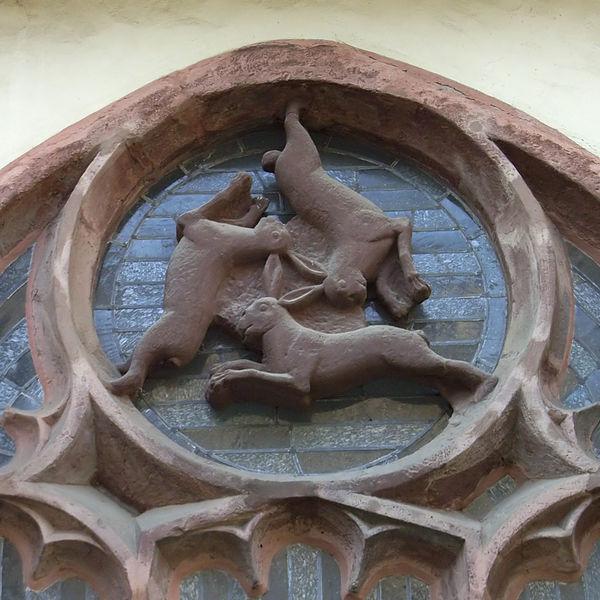 600px-Paderborner_Dom_Dreihasenfenster[1]